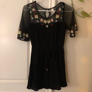 Dresses & Skirts - Black romper with floral embroidered detailing.